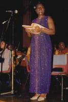 Margaret singing on the microphone