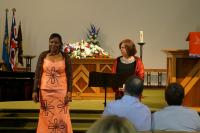 Margaret singing in duet